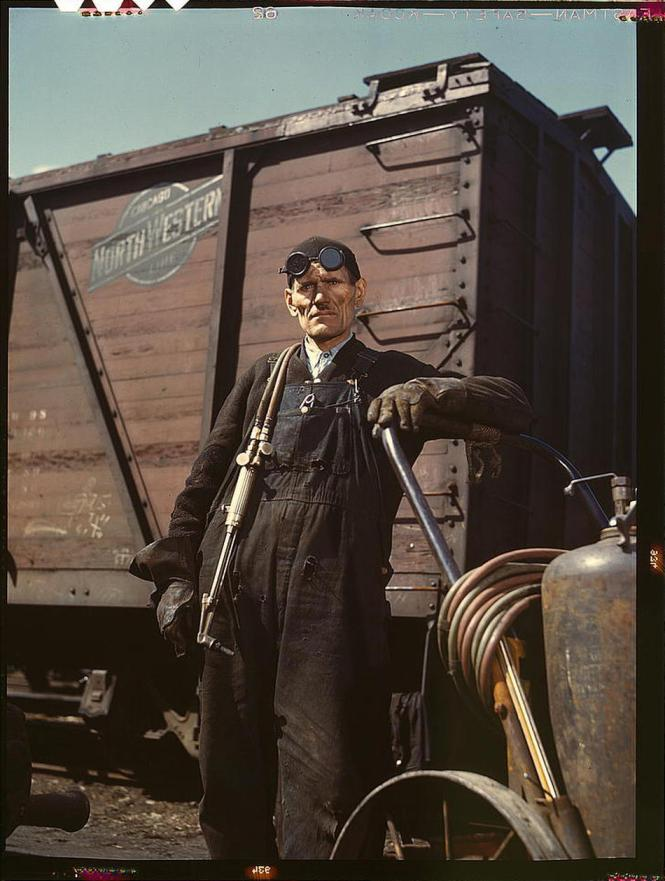 Mike Evans, a welder, at the rip tracks at Proviso yard of the Chicago and Northwest Railway Company. Chicago, Illinois, April 1943. Reproduction from color slide. Photo by Jack Delano. Prints and Photographs Divisio